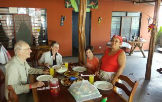 Costa Rica Sun Tours guests enjoying a home lunch with Dona Miriam