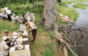 Finishing a Zambezi River canoe trip with a bush brunch on the river bank!