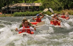 Canoeing the permanent rapid in front of Zambezi Sands is a thrill