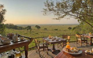 Bateleur Camp deck Masai Mara with Albatros East Africa courtesy &Beyond