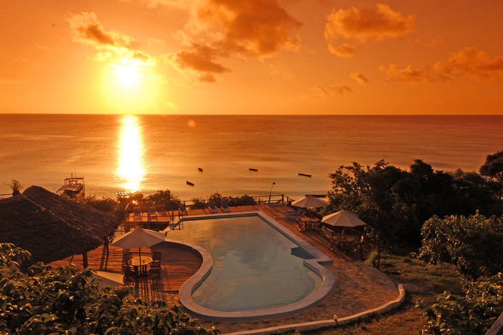 The Manta Resort pool at sunset