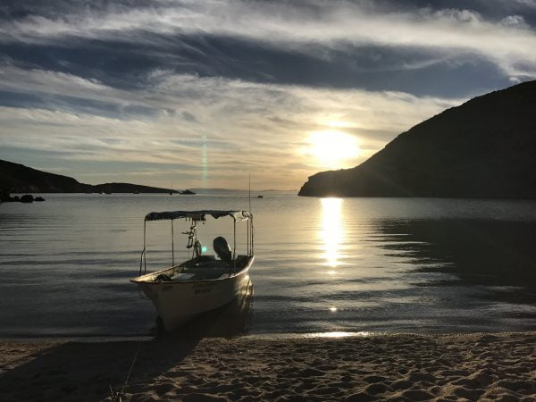 Colossus Camping boat view with Todos Santos Eco Adventures by Crystal Viks