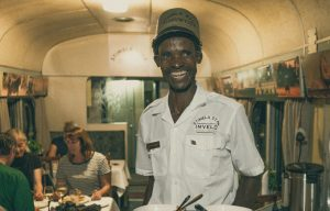 Dinner time on the Stimela and smiles all around! Photo: Mark Sissons